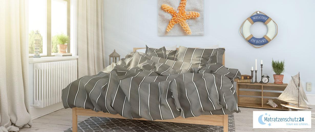 maritimes Schlafzimmer mit Seestern-Deko an der Wand